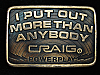 QI11161 1970s **I PUT OUT MORE THAN ANYBODY** CRAIG POWERPLAY STEREO BELT BUCKLE