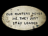KL15128 VINTAGE 1970s **HUNTERS NEVER DIE, THEY JUST STAY LOADED** BRASS BUCKLE