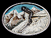 LC27155 VINTAGE 1986 ***DOWNHILL SKIIER IN SNOWY MOUNTAINS*** SPORTS BELT BUCKLE