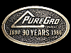 LF23102 VINTAGE 1980 ***PUREGRO COMPANY*** 90 YEARS BELT BUCKLE