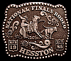 MG22105 VINTAGE 1985 HESSTON NATIONAL FINALS RODEO NFR (FRED FELLOWS ART) BUCKLE